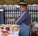 David Felce, the fishmonger, sleeves rolled up, with fish stall
