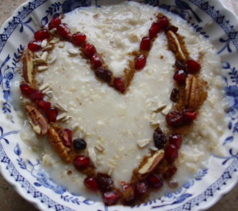 Porridge with heart-shaped cinnamon and nuts