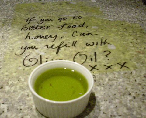 Spilt olive oil and reminder note to buy more