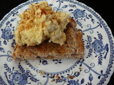 A blog of hummous on toast made with spelt on a plate