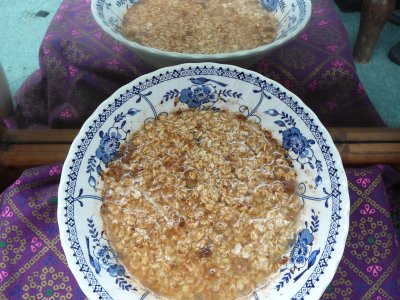 Oats with sultanas soaking in a cereal bowl in fron of a mirror