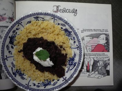 dark beetroot and lentils topped with yogurt on a bed of cooked millet