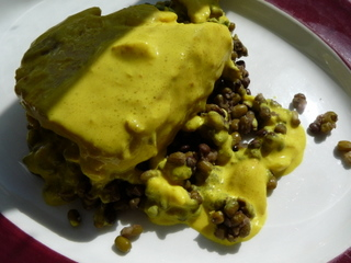 Salmon on a bed of lentils with coconut and turmeric