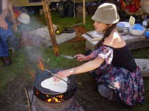 Chapatti cooking on open fire at Buddhafield festival 2008