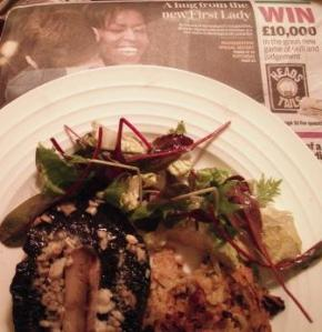 Rosti, garlic mushrooms and salad on a plate on today's Independent with pic of Michelle Obama