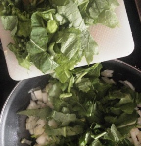 Cut-up turnip tops and into the pan they go