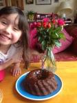 Happy grandchild with chocolate bean cake