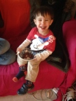 Two-year old enjoying my choco bean cake