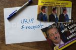 Ripped up UKIP leaflet with Freepost envelope ready to return.