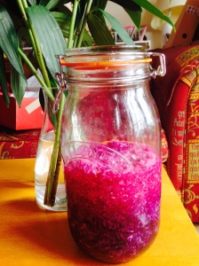 A jar of purple sauerkraut looking jewel-like