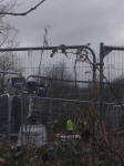 Bailliffs' steel fence and spotlights protest camp Metrobus Bristol