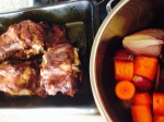 roasted bones and pan with carrots and onions