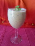 wine glass of creamy looking smoothie