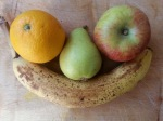 Apple, orange and pear in the curve of banana's