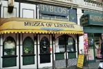 Exterior of Byblos with yellow awning with lettering, Mezza of Lebanon