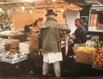 Fay Winkler shopping from Pat Wright fishmonger Tachbrook Street Market London SW1 in the 1980s
