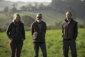 Farmers, Marina O'Connell, Bob Mehew and Dave Wright on the land at Huxhams Cross Farm