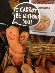 Entwined organic carrots with a label saying: I carrot leave without you!